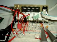 ATmega8 microcontroller runs the plasma globe