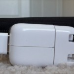 Showing iPad AC adapter next to case for thickness